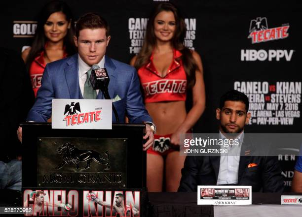 Boxer Saul 'Canelo' Alvarez from Mexico speaks as England's Amir Khan looks on during their final press conference at the MGM Grand in Las Vegas...