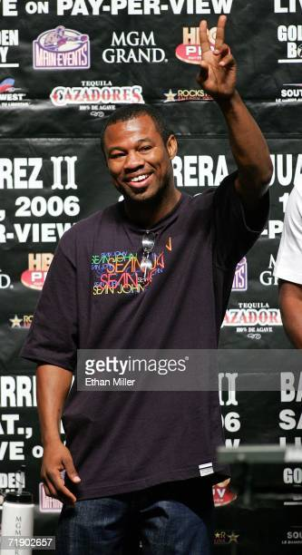 Boxer Shane Mosley acknowledges the crowd as he is introduced at the official weighin for WBC super featherweight champion Marco Antonio Barrera of...