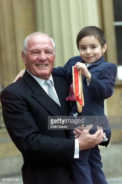 Boxer Sir Henry Cooper with his grandson after receiving a knighthood from the Queen at Buckingham Palace London 22nd Fenruary 2000