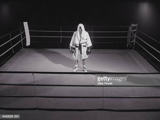 Boxer standing alone in ring (B&W)