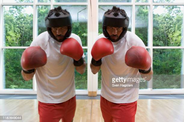 a boxer standing next to a mirror - boxing shorts stock pictures, royalty-free photos & images