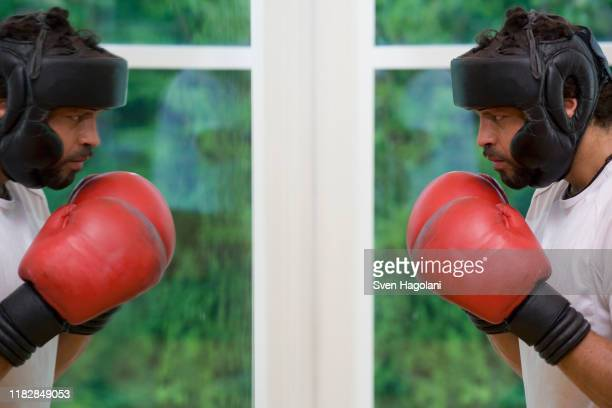 a boxer staring at his reflection - boxing shorts stock pictures, royalty-free photos & images