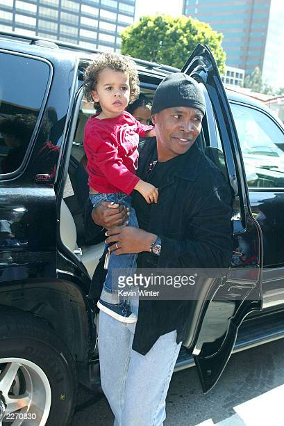 Boxer Sugar Ray Leonard and his son Daniel Ray arrive arrives at the premiere of Daddy Day Care at the National Theater on May 4 2003 in Los Angeles...