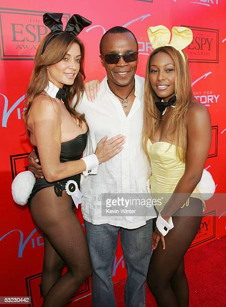Boxer Sugar Ray Leonard poses with Playboy Playmates Ava Fabian and Nicole Narain at Fight for Victory the 13th Annual Espy PreParty hosted by Andy...