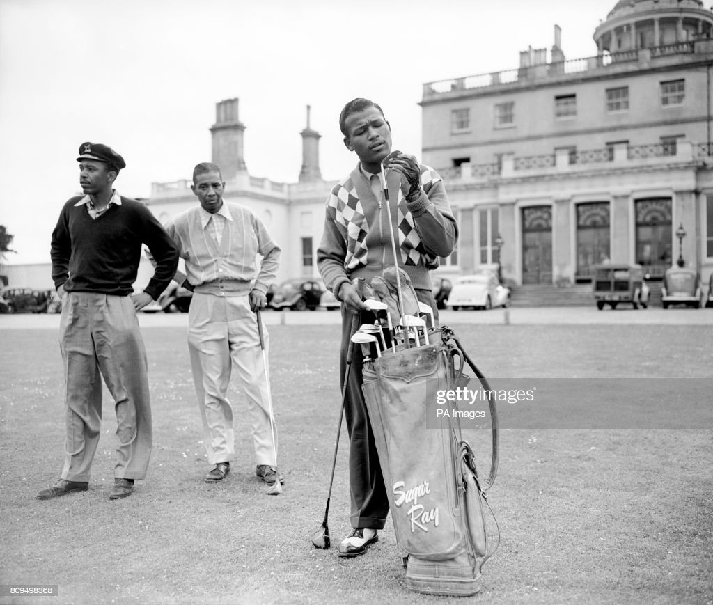 [Image: boxer-sugar-ray-robinson-inspects-one-of...d809498368]