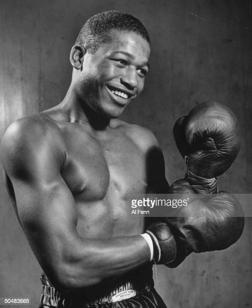 Boxer Sugar Ray Robinson posing with before a bout