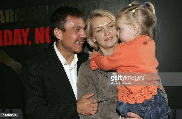 Boxer Super Lightweight World Champion Kostya Tszyu with his wife Natasha and daughter Anastasia at the final prefight press conference before his...