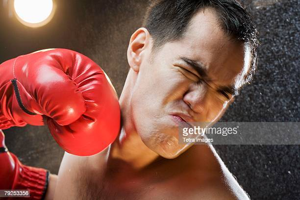boxer taking a punch to the head - punching stock pictures, royalty-free photos & images