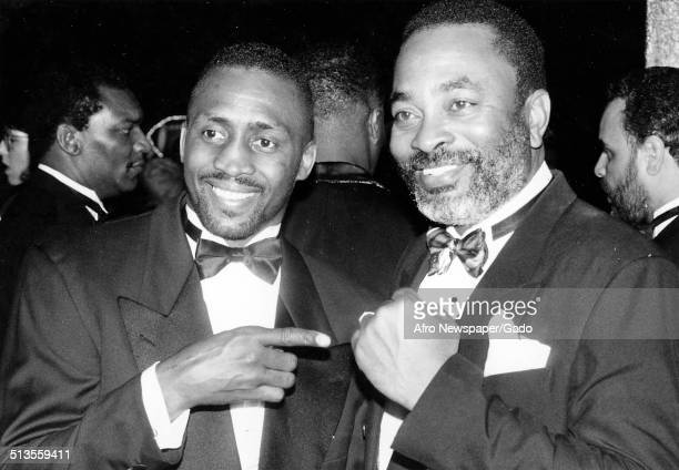 Boxer Thomas Hearns, left, and Lloyd Nash posing at a United Negro College Fund event, 1980.
