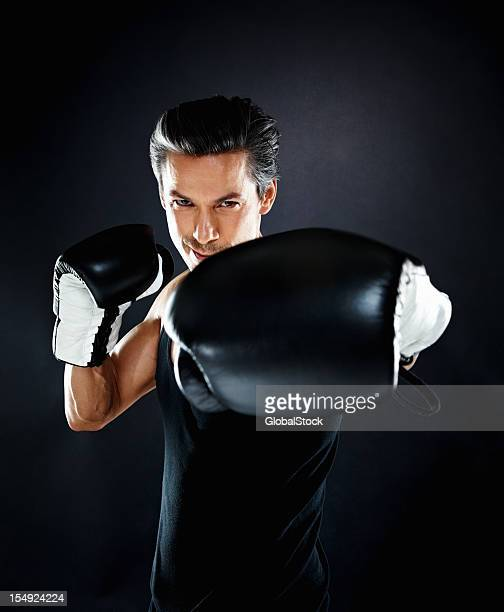 boxer throwing a punch - punching stock pictures, royalty-free photos & images