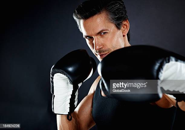 boxer throwing left hook - punching stock pictures, royalty-free photos & images