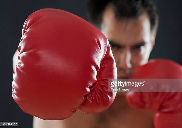 a boxer throwing punches - punching stock pictures, royalty-free photos & images