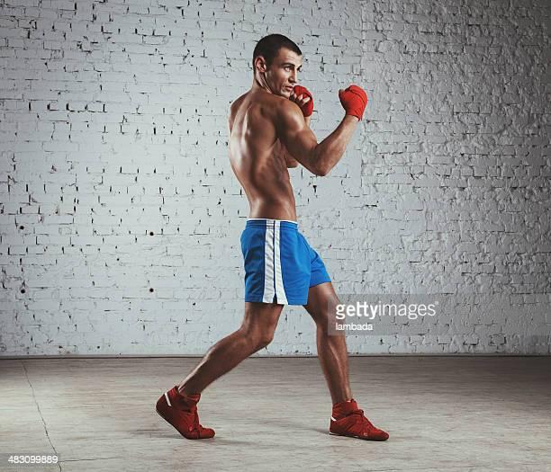 Boxer throwing uppercut