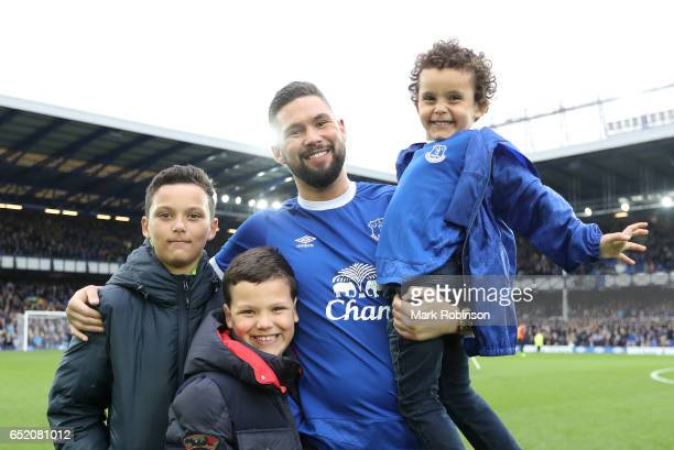 Boxer Tony Bellew poses with his sons at half time during the Premier League match between Everton and West Bromwich Albion at Goodison Park on March...