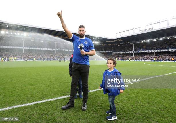Boxer Tony Bellew salutes the crowd at half time during the Premier League match between Everton and West Bromwich Albion at Goodison Park on March...