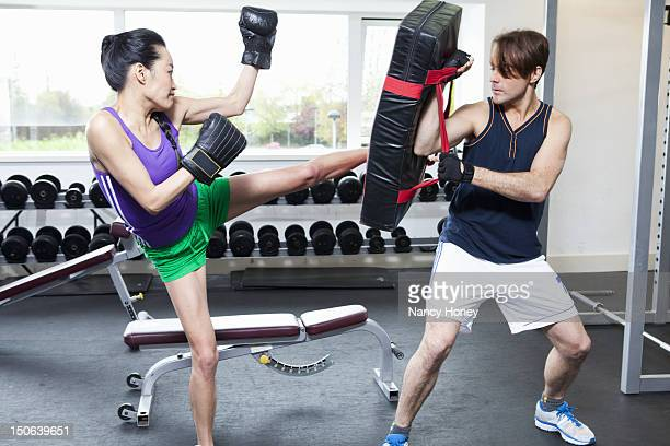 boxer training with coach in gym - padding stock pictures, royalty-free photos & images