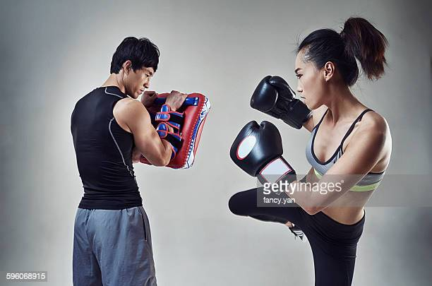 Boxer training with coach