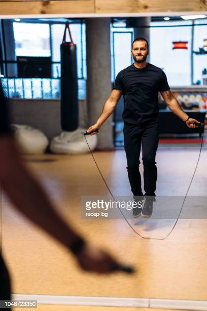 boxer training with jumping rope - skipping along stock pictures, royalty-free photos & images