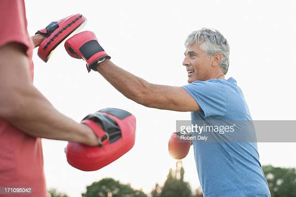 boxer training with sparring partner - sporting term stock pictures, royalty-free photos & images