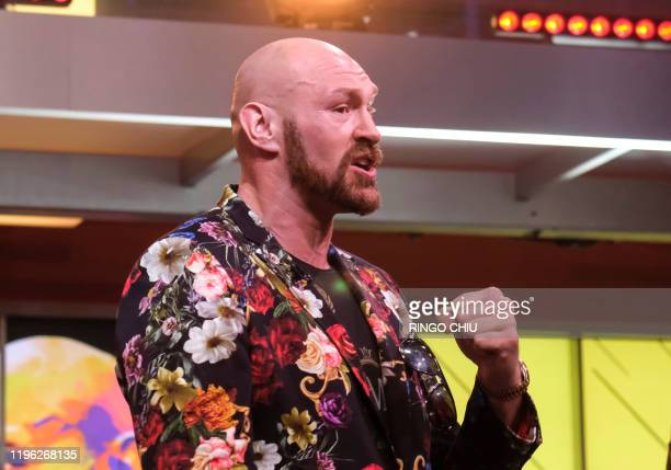 Boxer Tyson Fury speaks during a press conference with Deontay Wilder in Los Angeles California on January 25 2020 ahead of their rematch fight in...
