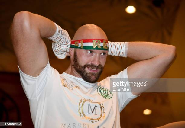 Boxer Tyson Fury ties a headband on as he prepares to work out at MGM Grand Hotel Casino on September 10 2019 in Las Vegas Nevada Fury will face Otto...