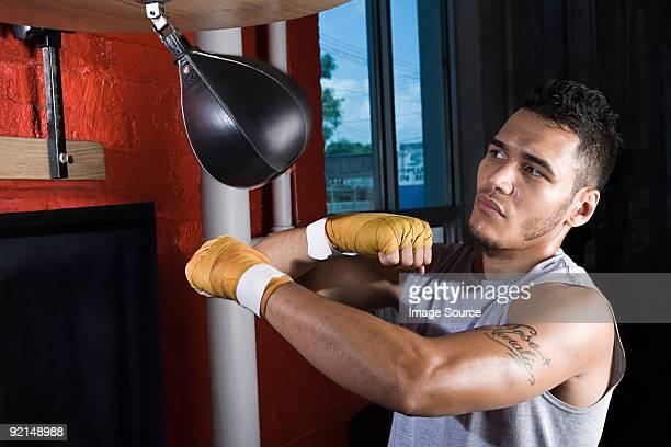 Boxer using punchbag
