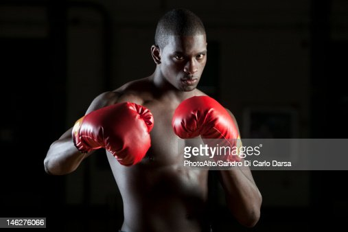 Boxer Wearing Boxing Gloves In Fighting Stance Portrait ...