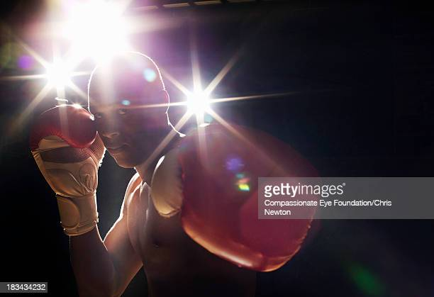 Boxer wearing gloves looking intimidating