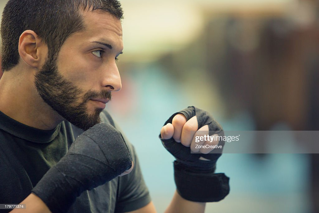 Boxer without boxer gloves in defensive position : Stock Photo