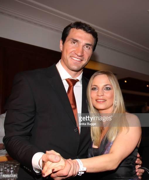 Boxer Wladimir Klitschko and boxer Regina Halmich attend the 'Felix Burda Award Gala 2009' after party at Hotel Adlon Kempinski on March 29, 2009 in...
