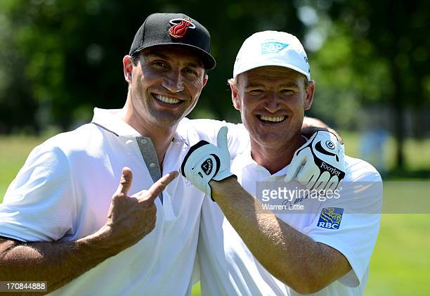 Boxer Wladimir Klitschko and Ernie Els pose for a picture during pro am ahead of the BMW International Open at Golfclub Munchen Eichenried on June 19...