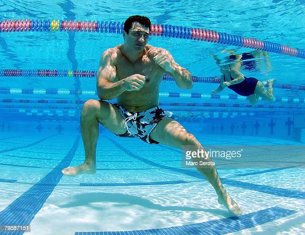 Boxer Wladimir Klitschko shadow boxes under water at the North County Aquatic Complex on February 6 2008 in Palm Beach Gardens Florida The IBF IBO...