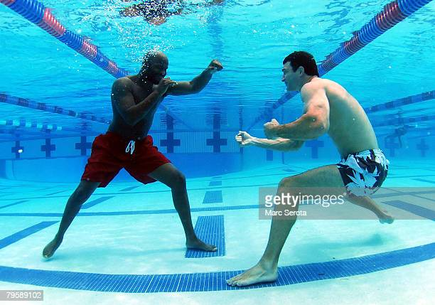Boxer Wladimir Klitschko shadow boxes under water with NABO Cruiserweight Champion Johnathon Banks at the North County Aquatic Complex on February 6...
