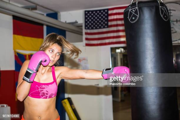 Boxer woman and punching bag