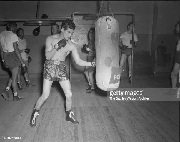 A boxer works the heavy bag in Stillman's Gym circa 1955 in New York City New York