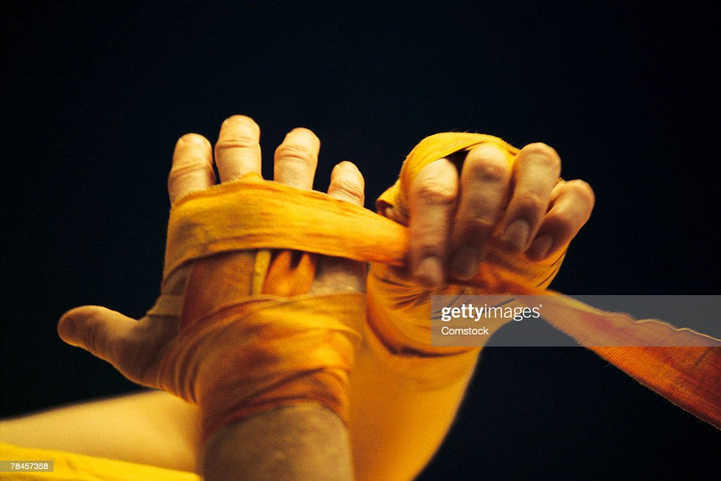 Boxer wrapping hands : Stock Photo