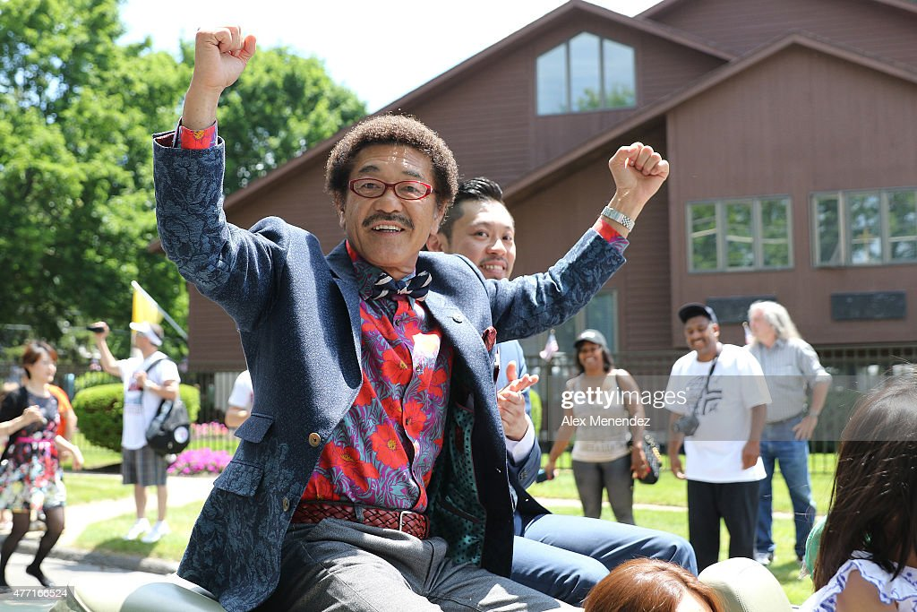 Boxer Yoko Gushiken is seen celebrating during the parade at the International Boxing Hall of Fame induction Weekend of Champions events on June 14, 2015 in Canastota, New York.