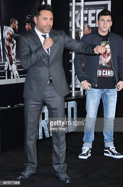 Boxer/President of Golden Boy Promotions Oscar De La Hoya and his son Devon De La Hoya attend the Premiere Of Warner Bros Pictures' 'Creed' at the...