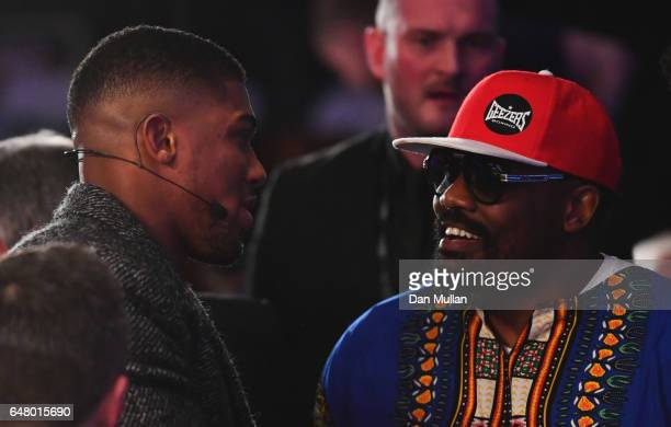 Boxers Anthony Joshua and Dereck Chisora in discussion at ringside at The O2 Arena on March 4 2017 in London England