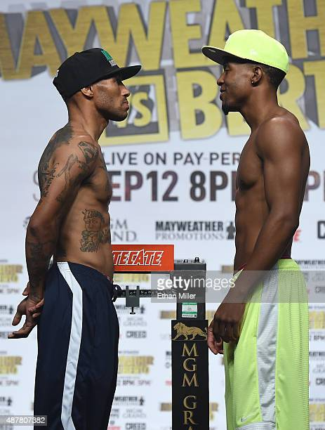 Boxers Ashley Theophane and Steven Upsher face off during their official weigh-in at MGM Grand Garden Arena on September 11, 2015 in Las Vegas,...