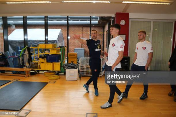Boxers Calum French and Pat McCormack meet Strength and Conditioning coach Adrian Lamb during a visit to the Academy of Light on February 6 2018 in...