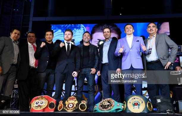 Boxers Canelo Alvarez and Gennady Golovkin pose with their promoters trainers and actorhost Mario Lopez after a news conference at Microsoft Theater...