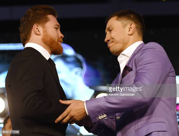 Boxers Canelo Alvarez and Gennady Golovkin shake hands during a news conference at Microsoft Theater at LA Live to announce their upcoming rematch on...