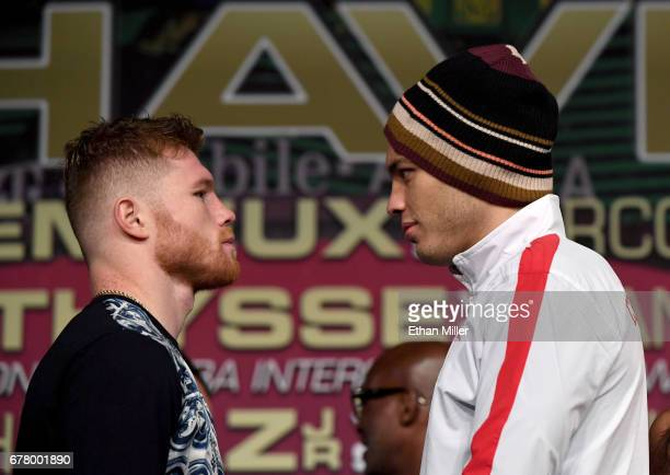 Boxers Canelo Alvarez and Julio Cesar Chavez Jr face off during a news conference at the KA Theatre at MGM Grand Hotel Casino on May 3 2017 in Las...