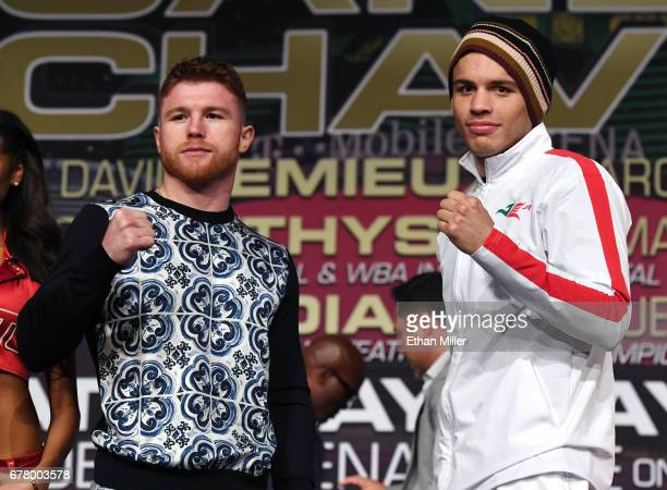 Boxers Canelo Alvarez and Julio Cesar Chavez Jr pose during a news conference at the KA Theatre at MGM Grand Hotel Casino on May 3 2017 in Las Vegas...