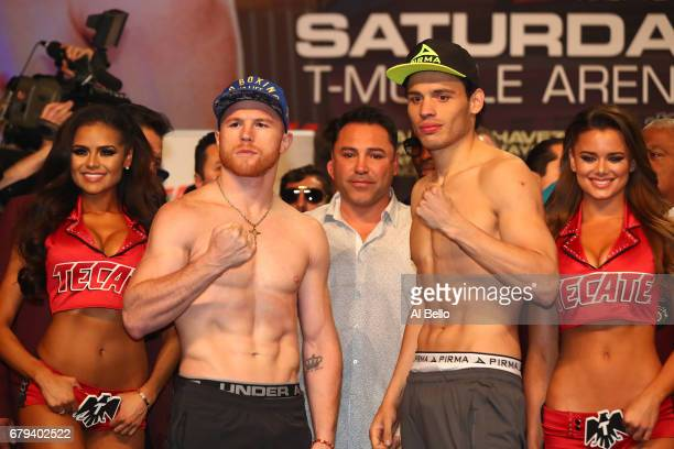 Boxers Canelo Alvarez and Julio Cesar Chavez Jr pose during their official weighin at MGM Grand Garden Arena on May 5 2017 in Las Vegas Nevada The...