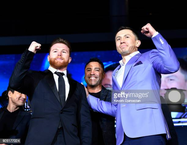 Boxers Canelo Alvarez boxing promoter and former professional boxer Oscar De La Hoya and Gennady Golovkin pose during a news conference at Microsoft...