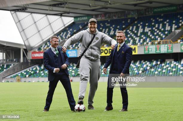 Boxers Carl Frampton, Tyson Fury and Paddy Barnes attend a photo call at Windsor Park on June 18, 2018 in Belfast, Northern Ireland. The three boxers...