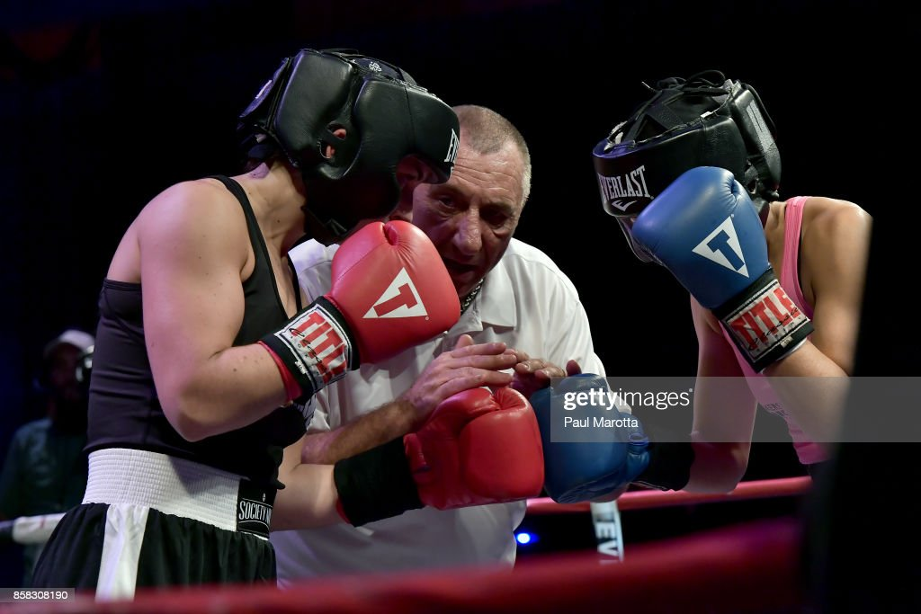 Boxers Caroline Lombardi and Marissa Polichene in the ring at the Haymakers for Hope Fundraiser - 2017 Belles of the Brawl at House of Blues Boston on October 5, 2017 in Boston, Massachusetts. Organizers estimate app. $450,000 was raised with this single event in Boston nd more than $7.5m since its inception. Amature boxers train for four months with professional trainers and step into the ring to fight a professionally organized boxing match to raise money and awareness for cancer research.