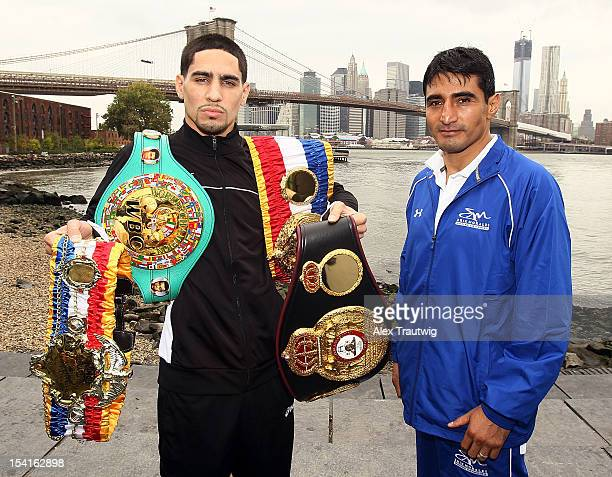 Boxers Danny Garcia and Erik Morales pose during a photo call in front of the Brooklyn Bridge on October 15 2012 in the Brooklyn borough of New York...